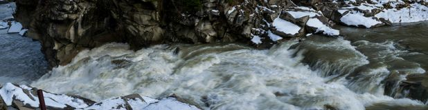 Panorama of the rapid flow of water. Mountain river Prut in Ukrainian Carpathians royalty free stock photography