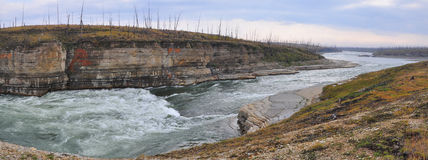 Panorama of rapid in a rocky canyon. Stock Photos
