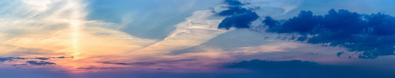 Panorama ray sun clouds sunset sunrise. Background panorama. ray of the sun make their way through clouds. sunset and sunrise Stock Images