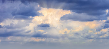 Panorama rays of the sun dramatic clouds. Background panorama. rays of the sun make their way through dramatic clouds Royalty Free Stock Photography