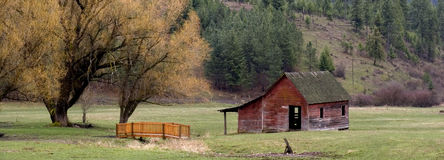 Panorama of a red barn. A panoramic of a red barn in a pasture Stock Photo