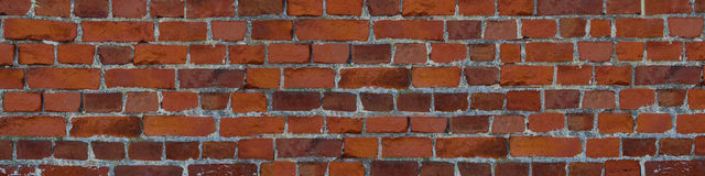 Panorama red brick wall orange masonry uneven wide Stock Photography