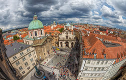 Panorama of red roofs of Prague and Charles Square royalty free stock photography