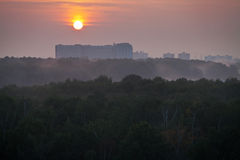 Panorama of red sunrise over city Stock Images