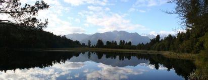 Panorama - Reflection on Lake Matheson, New Zealand. Beautiful reflection on Lake Matheson, New Zealand stock image