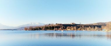 Panorama of a relaxing blue lake. The beautiful lake of Viverone Italy in a relaxing autumn day royalty free stock image