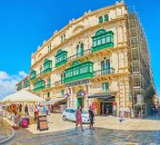Panorama of Republic Street, Valletta, Malta. VALLETTA, MALTA - JUNE 17, 2018: Panorama of historical mansion in Republic street with stores and stalls on the Stock Photos