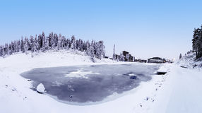 Panorama resort Ruka. View of the Ruka Village and ice-covered lake Kaltiolampi Stock Photo