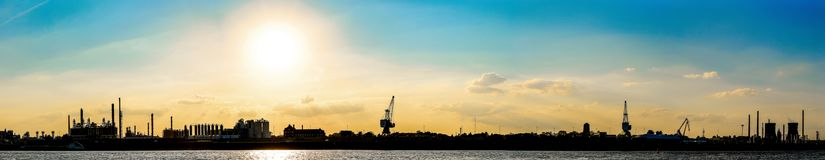 Panorama of Rhein River at Cologne, Germany at sunset. Sunset over industrial area outside Cologne, Germany along Rhein River Stock Image