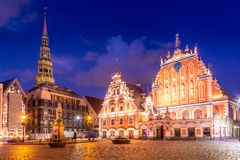 Panorama of Riga Old Town Hall Square, Roland Statue, The Blackheads House and St Peters Cathedral illuminated in the twilight, royalty free stock photography
