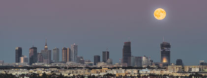 Panorama of rising moon over Warsaw city, Poland Stock Photography