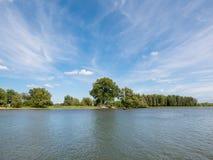 Panorama of river Afgedamde Maas near Woudrichem, Netherlands. Panorama of river Afgedamde Maas with ferry boat near Woudrichem, Netherlands Royalty Free Stock Photography