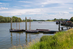 Panorama of river Afgedamde Maas near Woudrichem, Netherlands. Jetty and boats on river Afgedamde Maas near fortified town of Woudrichem, Brabant, Netherlands stock photography