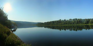 Panorama of the river with calm water Stock Images