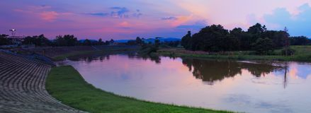 Panorama river city park and sunset in sky beautiful twilight time.  Stock Images