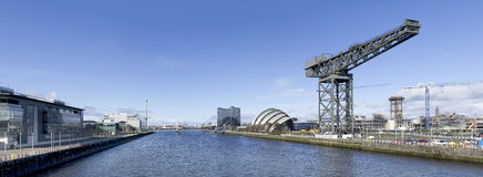 Panorama of River Clyde in Glasgow. High resolution panorama of the River Clyde in Glasgow showing Finnieston Crane, Armadillo, Bell's Bridge and Science Tower Royalty Free Stock Images