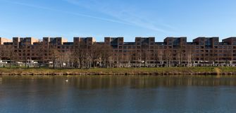 Panorama of River Maas in front of a line of apartments in Maastricht stock images