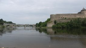 Panorama of the river Narva with Ivangorod fortress and the castle of Herman. The border of Russia and Estonia stock video