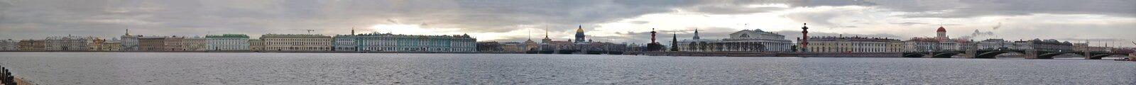 Panorama of river Neva embankment. Including Winter Palace, Palace Dvorcoviy bridge, Strelka of the Vasilievskiy Island, Admiralty, Saint Isaac's Cathedral Royalty Free Stock Image