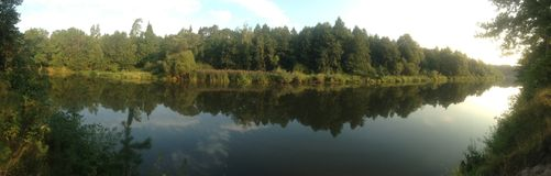 Panorama on the river. Russia river sun early morning forest trees greens water Stock Image