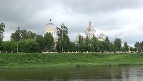 Panorama of the river Tvertsa overlooking Spasopreobrazhensky Cathedral and the Vhodoierusalimskuyu Church. Torzhok, Russia stock video