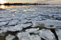 Panorama of river valley with spring ice drifting at sunset Royalty Free Stock Photography