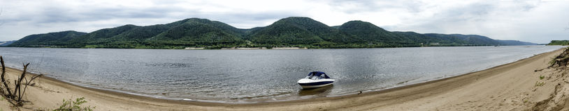 Panorama of the river Volga. And mountains and a boat on the shore Royalty Free Stock Photo