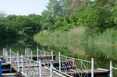 Panorama of the river with wooden bridge. On the river Samara, Ukraine royalty free stock image