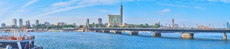 Panorama of Qasr El Nil bridge, Cairo, Egypt. Panorama of rivrside area with a view on Qasr El Nil bridge, stretching across the Nile river to Gezira Island royalty free stock photos
