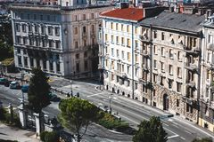 Panorama of the road and the facades of the houses stock image
