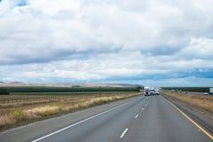 Panorama with road traffic of semi trucks and van Stock Photo