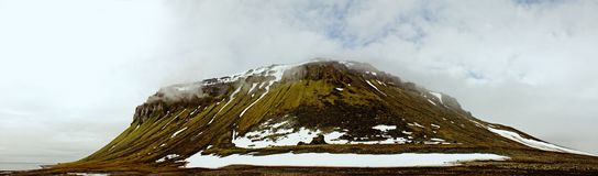 Panorama Rock. This geological uplift is located on Franz Josef Land. 900 km from North pole. Famous among conquerors of North pole Cape Flora with colonies of royalty free stock photos
