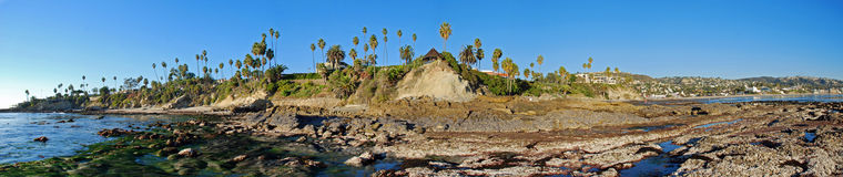 Panorama of Rock Pile Beach, Heisler Park and Laguna Beach, California. The image give an expansive view of Rock Pile Beach (left side), Heisler Park (above royalty free stock images