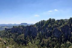 Panorama with rocks Bastei, table mountain Lilienstein and hotel in Rathen, Saxon Switzerland Stock Photos
