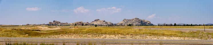 Panorama of rocks. Buford, Wyoming, United States - August 15, 2018: Panoramic shot of the area surrounding `Tree in the Rock` point of interest along interstate Stock Image