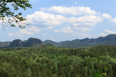 Panorama with rocks, mountains and forest seen from Kuhstall in Saxon Switzerland Stock Photos