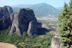 The rocks of St. Meteora in the central part of Greece. 06. 18. 2014. Landscape of mountainous nature, settlements and religious o. Panorama of the rocks of St Royalty Free Stock Photo