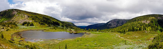 Panorama of rocky coast and mountains near Lake Baikal.  Royalty Free Stock Images