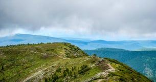 Panorama of rocky coast and mountains near Lake Baikal.  Royalty Free Stock Photos