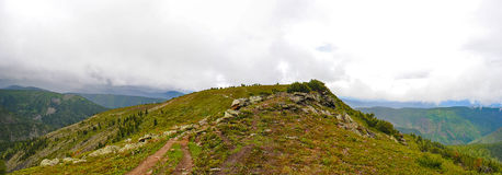 Panorama of rocky coast and mountains near Lake Baikal.  Royalty Free Stock Image