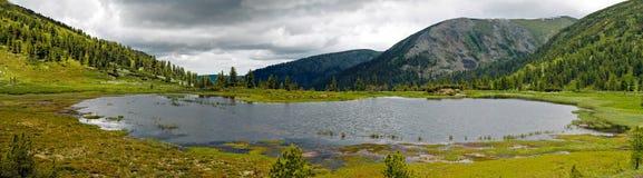 Panorama of rocky coast and mountains near Lake Baikal.  Stock Photography