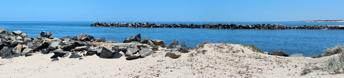 Panorama of rocky fishing groynes at the Cut West Australia royalty free stock photos