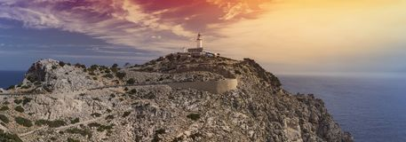 A panorama of the rocky landscape and the Formentor lighthouse on top of the Cap de Formentor, Mallorca, Spain. A panoramic picture of the windy road leading up Stock Photo