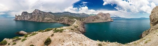 Panorama of rocky sea coast and blue sky royalty free stock photos
