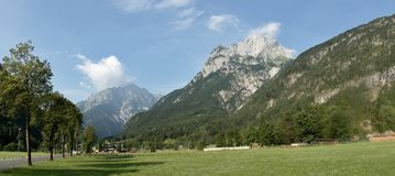 Panorama with Rombon and Jerebica mountains from from Log pod Mangartom in Triglav national park in Julian Alps in Slovenia Stock Image