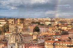 Panorama of Rome from Altar of Fatherland at evening rainy day in Rome, Italy. Overcast sky with a rainbow Stock Photo