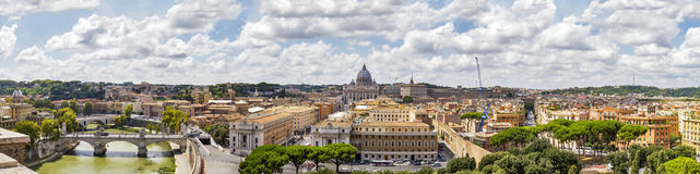 Panorama of Rome, Italy. Panorama view over Rome, Italy with Saint Peter's Dome, the Vatican, the Tiber river, bridges and buildings Royalty Free Stock Photos