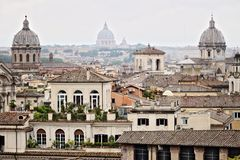 Panorama of Rome`s rooftops with three church domes. Photograph royalty free stock images