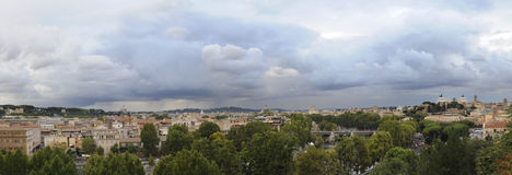 Panorama of Rome under cloudy sky. Panoramic view of Rome from the dome of St. Peter the Vittoriano under a cloudy sky royalty free stock photography