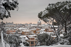 Panorama of Rome under snow. This picture was taken february 4th 2012, after one of the heaviest snowfall in Rome since 1985. This is the view from Pincio hill Royalty Free Stock Photo